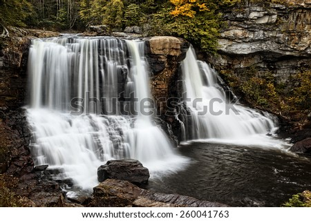 Blackwater Falls West Virginia  during autumn colors. This 62 foot cascading waterfall looks it's best with peak autumn colors in the trees.  - stock photo
