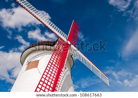 Blades of a wind turbine in the sky. - stock photo