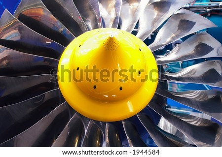 Blades of the turbine of the jet engine - stock photo