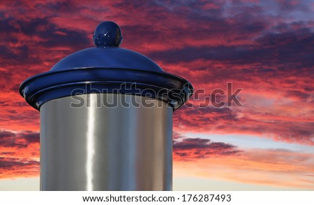 Blank advertising column in front of sky with sun rise - stock photo