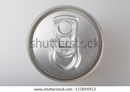 Blank aluminum soda can on a aluminum background - stock photo