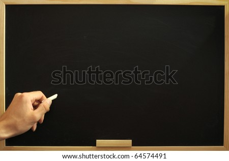 blank and empty chalkboard with hand and copyspace for text - stock photo