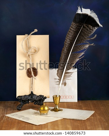 Blank Antique letter with feather pen and a candle - stock photo