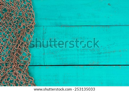 Blank antique teal blue aged wooden sign background with fish net border - stock photo