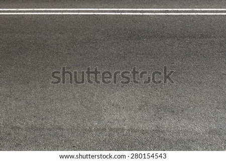 Blank asphalt road with separation lines - stock photo