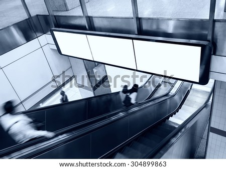 Blank Banner Billboard Display with escalator and people in subway station - stock photo