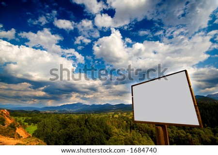 Blank billboard agains a nive blue sky with clouds - stock photo