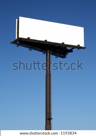 Blank billboard against a blue sky.  The sign itself has been blanked out for placement of your own artwork or ad. - stock photo