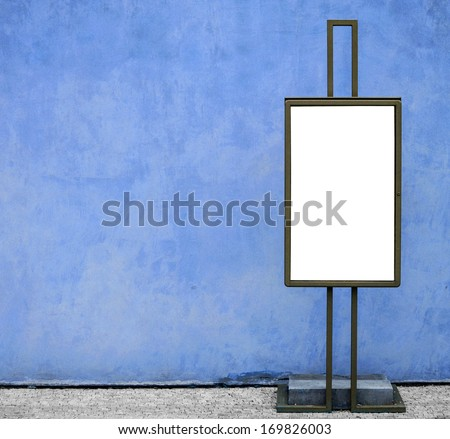 Blank billboard against blue concrete wall - stock photo