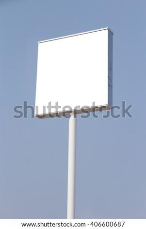 Blank billboard against blue sky. - stock photo