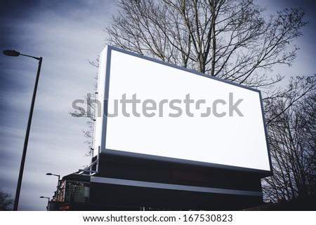 Blank billboard at angle - stock photo