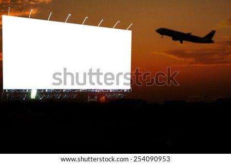 blank billboard at evening time for advertisement. silhouette sunset and flying plan.  - stock photo