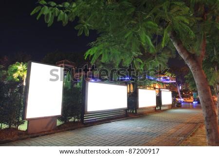 Blank billboard at night - stock photo