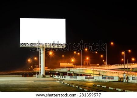 Blank billboard at night for advertisement. - stock photo