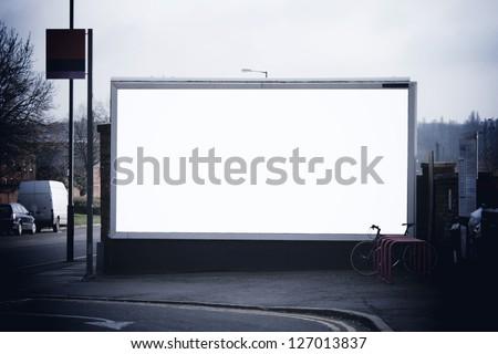 Blank billboard at train station - stock photo