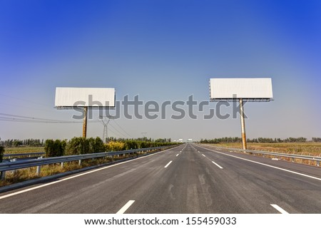 Blank billboard by the highway - stock photo