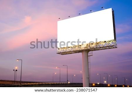 Blank billboard for advertisement at twilight  - stock photo