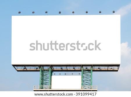 Blank billboard for advertisement on blue sky. - stock photo