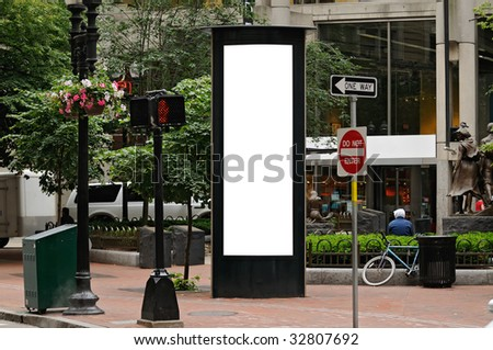 Blank billboard for outdoor advertising on side of modern telephone booth - stock photo