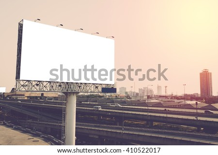 Blank billboard in big city. Vintage filter - stock photo