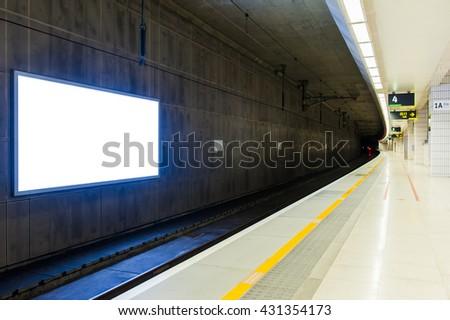Blank billboard in modern underground hall - stock photo