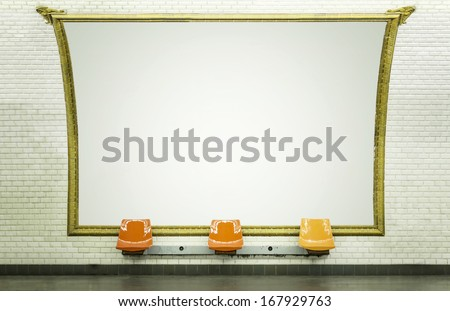 Blank billboard in Paris subway station with empty chairs - stock photo
