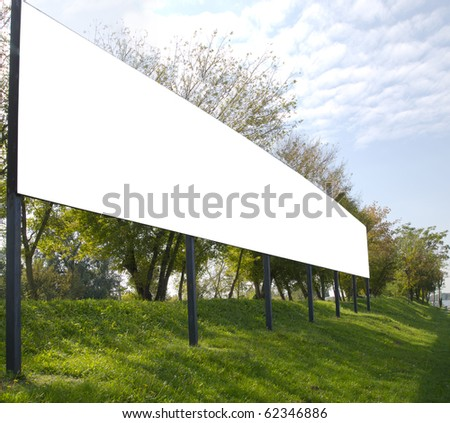 blank billboard in the beautiful landscape, appropriate for your ad - stock photo