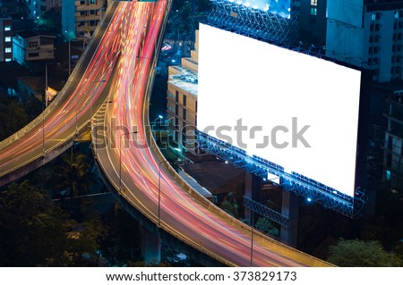 blank billboard in the night time for advertisement. long exposure makes long street light tails. - stock photo