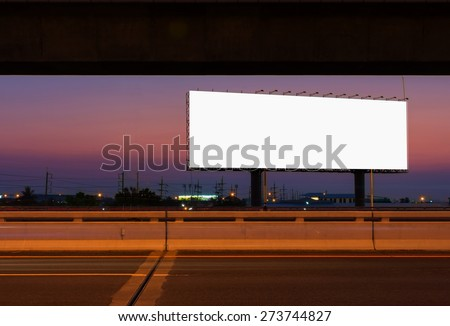 blank billboard is between air train railroad and expressway  this Car Lights in twilight time. - stock photo
