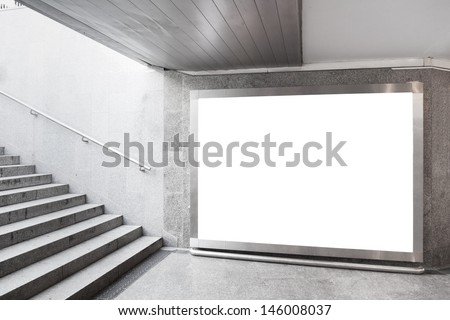 Blank billboard located in underground hall - stock photo