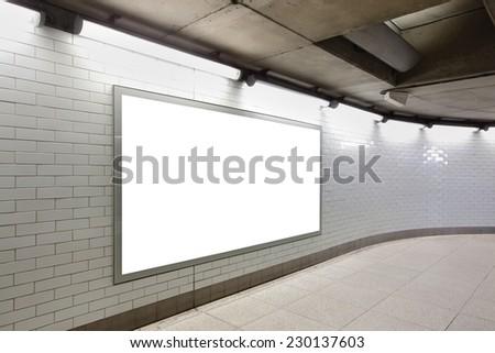 Blank billboard located in underground hall, London, United Kingdom, uk - stock photo