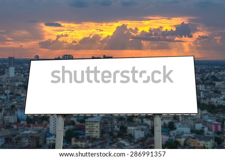 Blank billboard on beautiful sky over the cityscape at sunset - stock photo