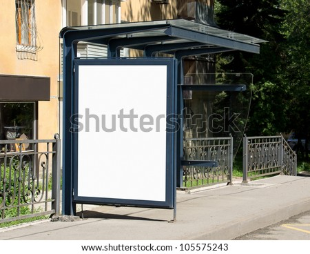 Blank Billboard on Bus Stop for your advertising situated (with work path) - stock photo