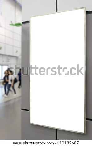 Blank billboard on modern gray wall with blued passenger background - stock photo