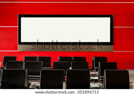 Blank billboard on modern red wall in airport with seating, - stock photo