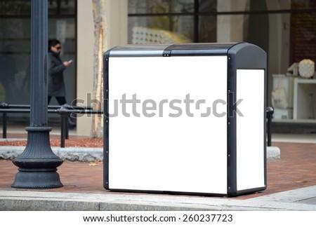 Blank billboard on solar recycling kiosk - stock photo