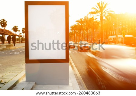 Blank billboard outdoors, outdoor advertising mock up, public information board on city road, flare sun light - stock photo