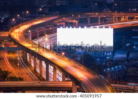Blank billboard ready for new advertisement at Motorway, Expressway, Freeway in modern city downtown, urban view at night time - stock photo