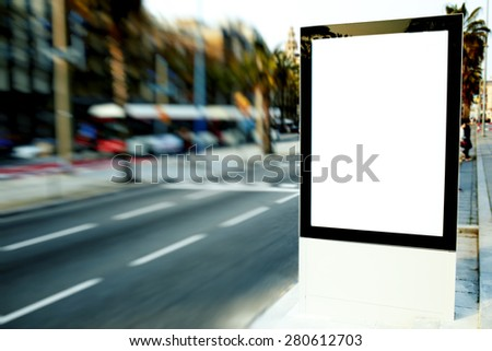 Blank billboard with copy space for your text message or content, outdoors advertising mock up, public information board on city road, motion blur effect, filtered image - stock photo