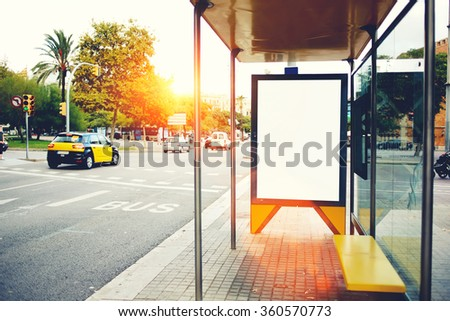 Blank billboard with copy space for your text message or promotional content, empty public information board in the big city, advertising mock up empty banner in metropolitan city on a bus station - stock photo