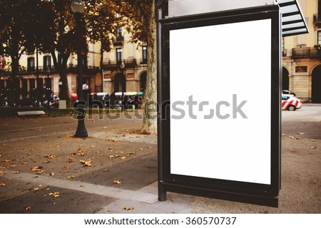 Blank billboard with copy space for your text message or promotional content, public information board on the street, advertising mock up empty banner in metropolitan city, clear poster on a bus stop - stock photo