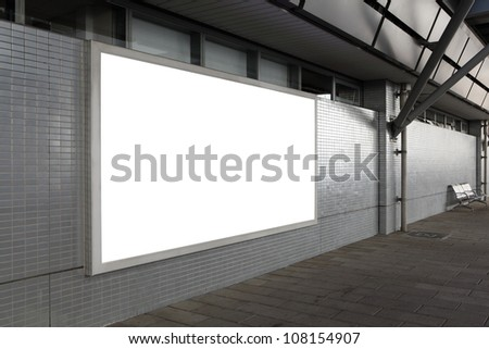 Blank billboard with empty copy space (path in the image) on the street - stock photo