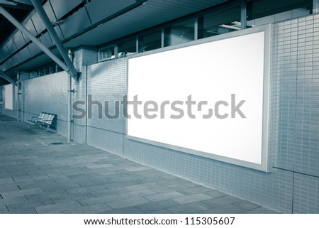Blank billboard with empty copy space (path in the image) on the street in blue tune - stock photo