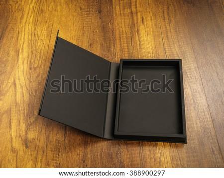 Blank black box mock up on wood background - stock photo