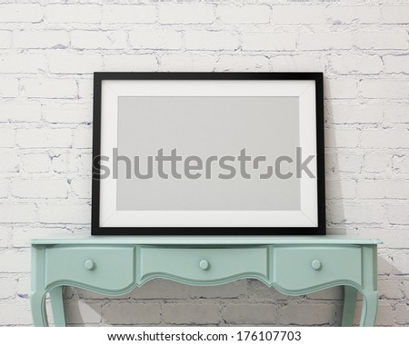 blank black picture frame on the white desk and wall, background - stock photo
