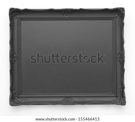 Blank black picture frame on white wall - stock photo