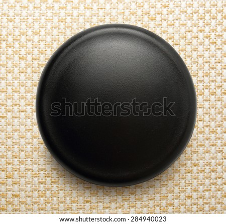Blank black round badge on background - stock photo