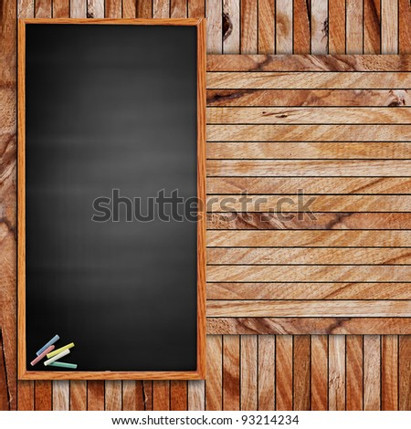 blank blackboard and chalk. on wood with copy-space for writing - stock photo