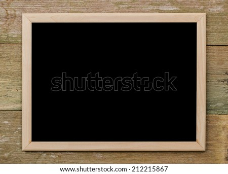 blank blackboard copy space with wood frame on old wooden background. - stock photo