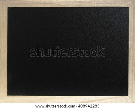 Blank blackboard with wooden frame. - stock photo